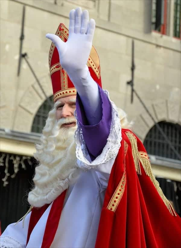 man dressed up in a bishops costume for a parade to celebrate St Nicholas day