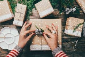 woman's hands tying up twine on Christmas gifts