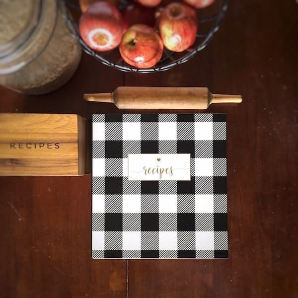 recipe box, recipe binder and rolling pin on a table top