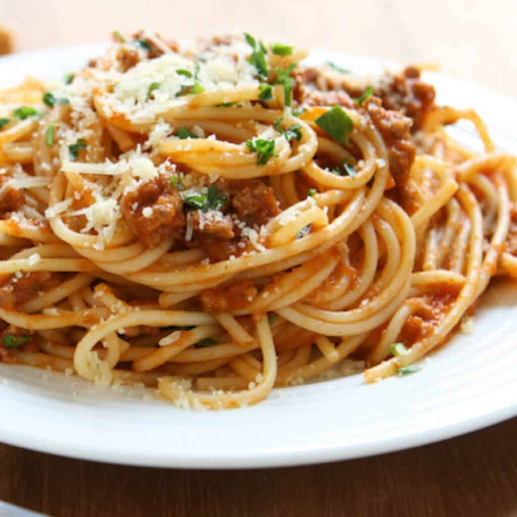 pasta with meat sauce on a white plate