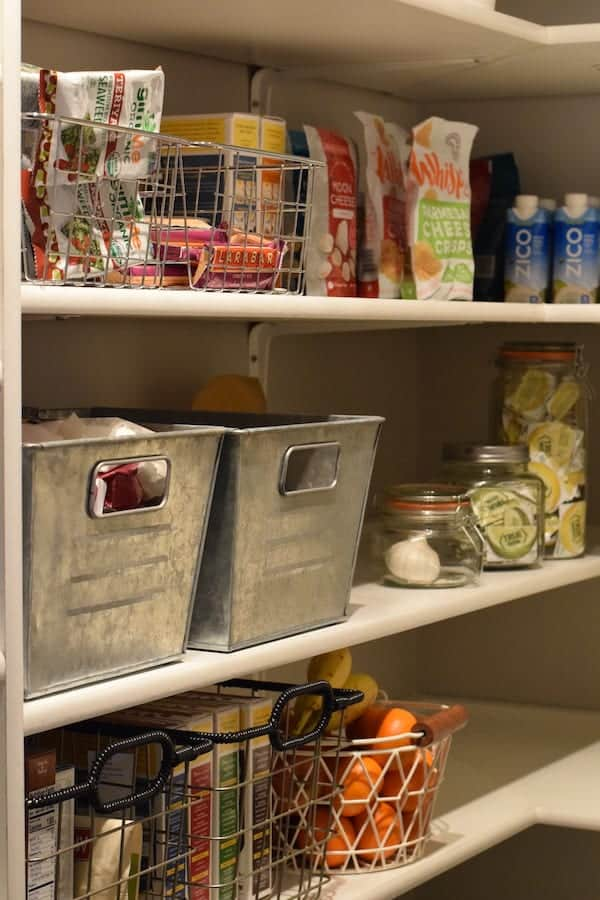 another kitchen pantry view with galvanized bins and wire baskets
