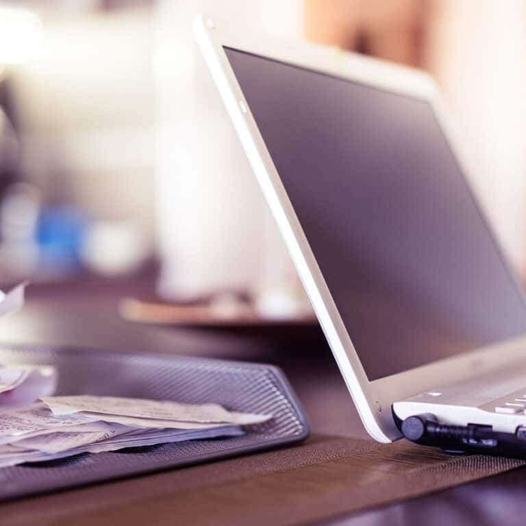 laptop and receipt organization on desk