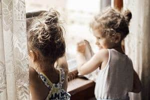 little girls helping clean windows