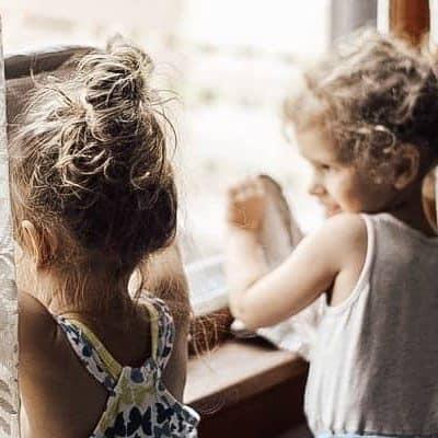 little girls helping clean windows