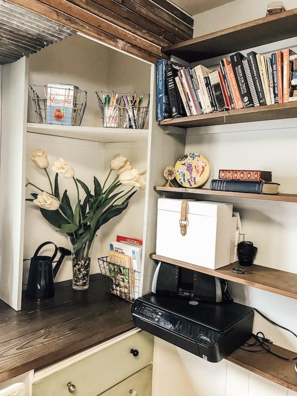 books, arts and crafts on a shelf