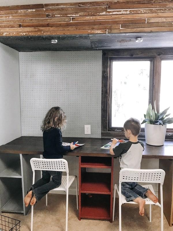 children doing schoolwork at desk