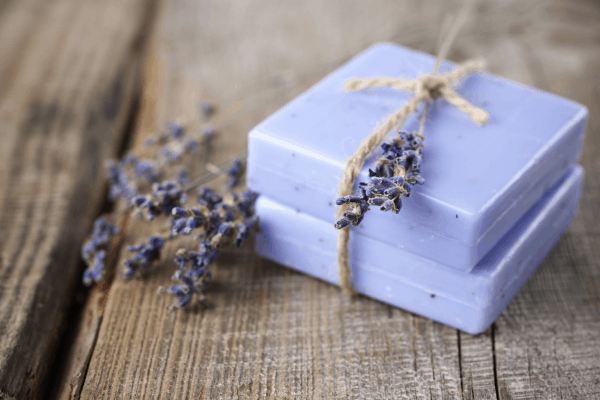 lavender soap bars on a wood table