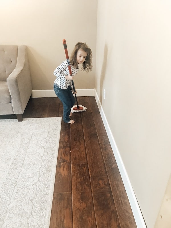 little girl mopping the floor