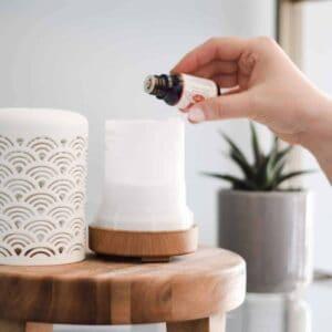 using essential oils in a pretty white diffuser