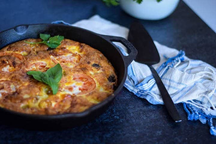 finished mediterranean frittata in a cast iron skillet, a perfect healthy egg recipe