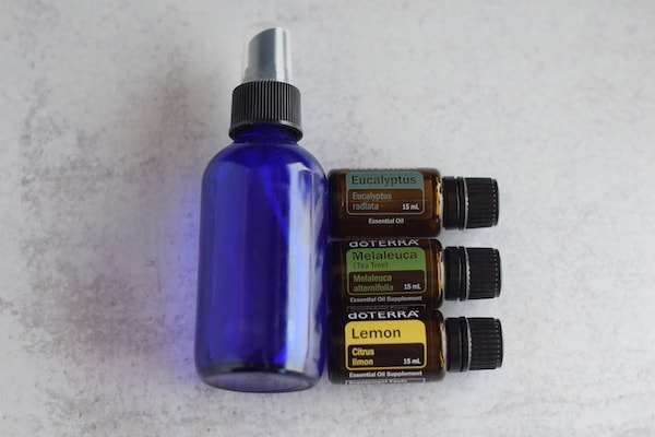 essential oils with blue glass spray bottle