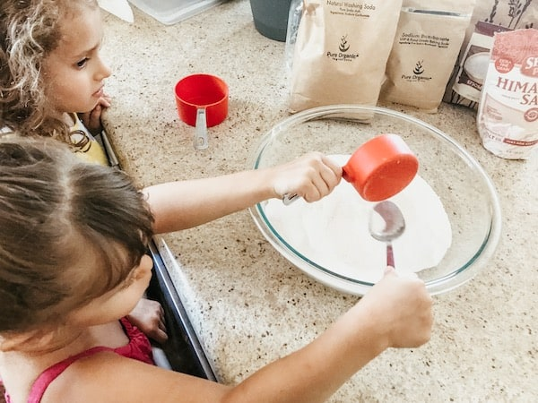 girls mixing up the laundry detergent