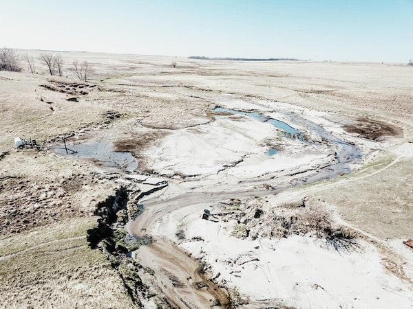 drone view of aftermath of recent flooding on the ranch