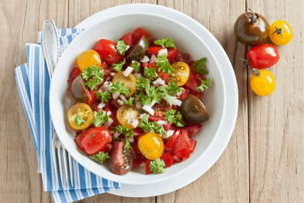 fresh tomato salad in a white bowl