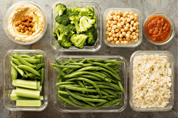 vegetables, grains, and beans in meal prep bowls