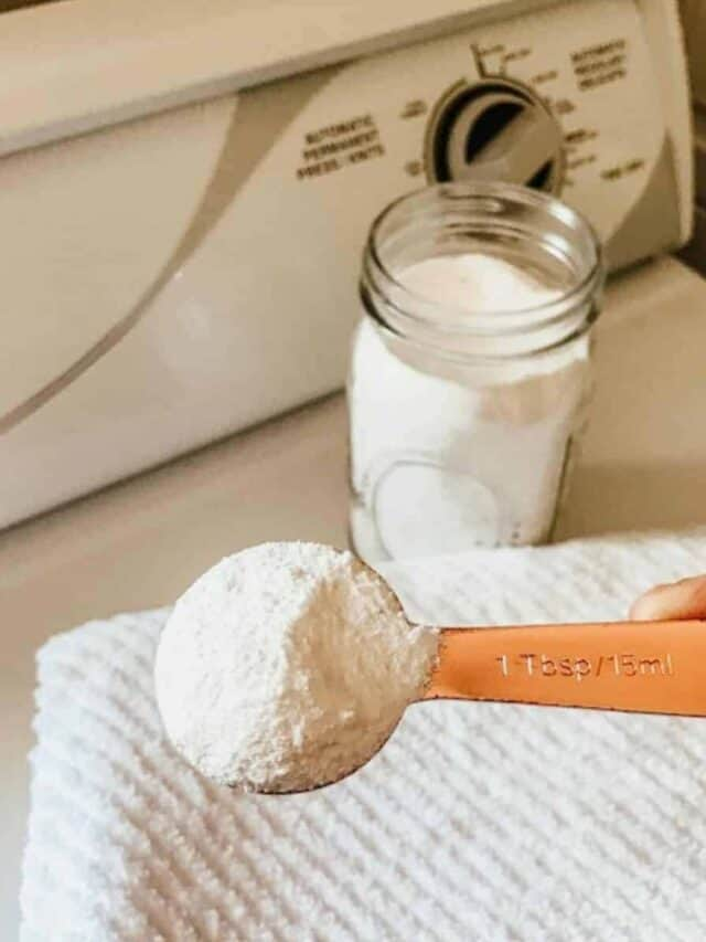 homemade laundry detergent in a mason jar with a measuring spoon