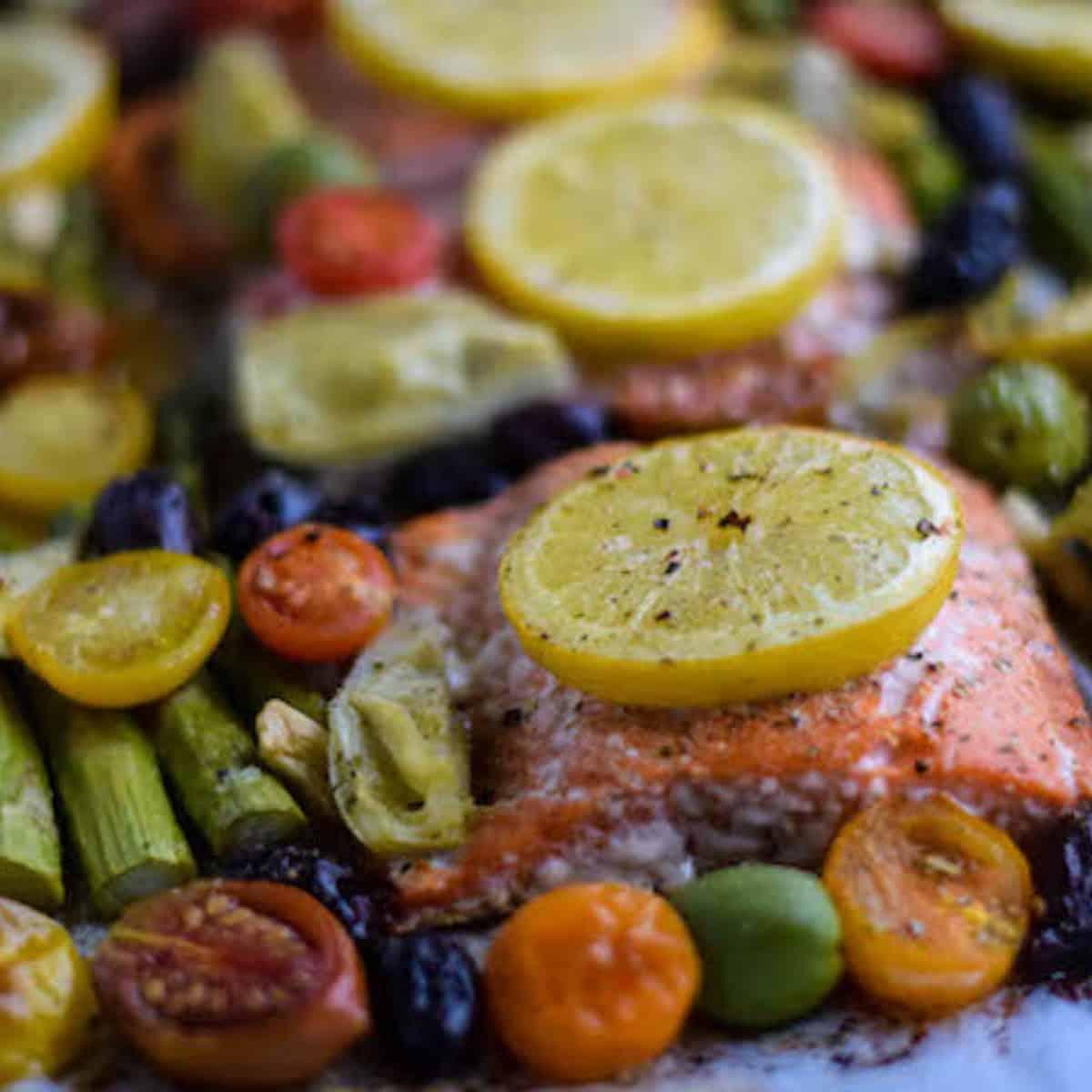salmon sheet pan with lemon slices on top