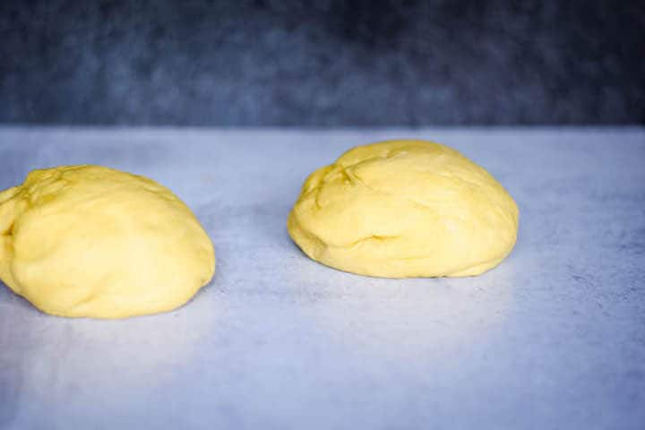 two homemade pizza dough balls