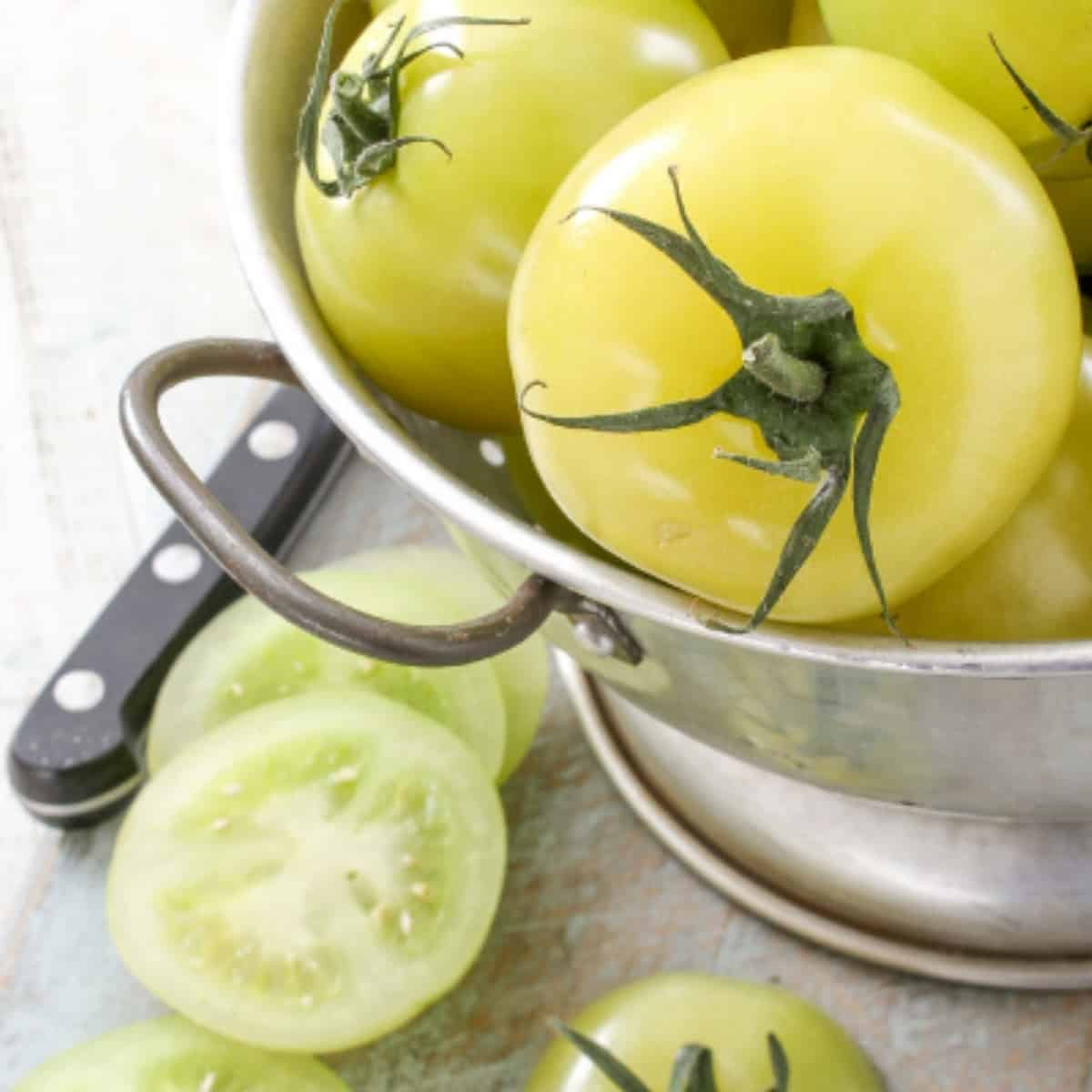 fresh picked fried green tomatoes in a collander