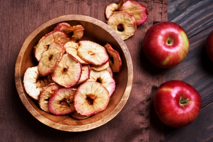 dehydrated apples in a wooden bowl