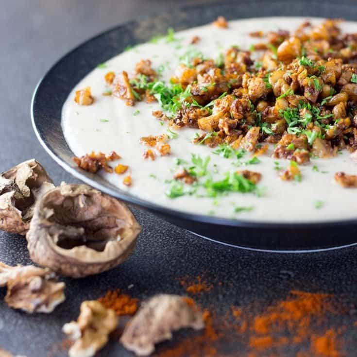 Cauliflower and walnut soup with a smoky crumb topping