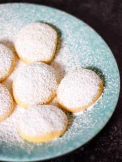 finished greek butter cookies on a blue plate