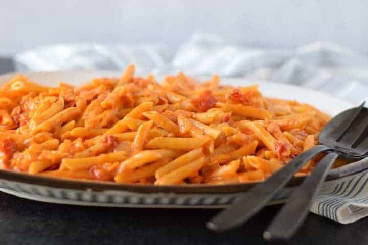 creamy pomodoro sauce with pasta on platter