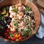 Mediterranean grain bowl with wooden spoons