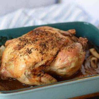 Italian roast chicken in a blue baking dish