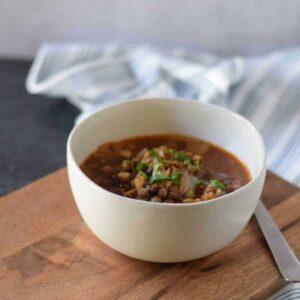greek lentil soup in a white bowl
