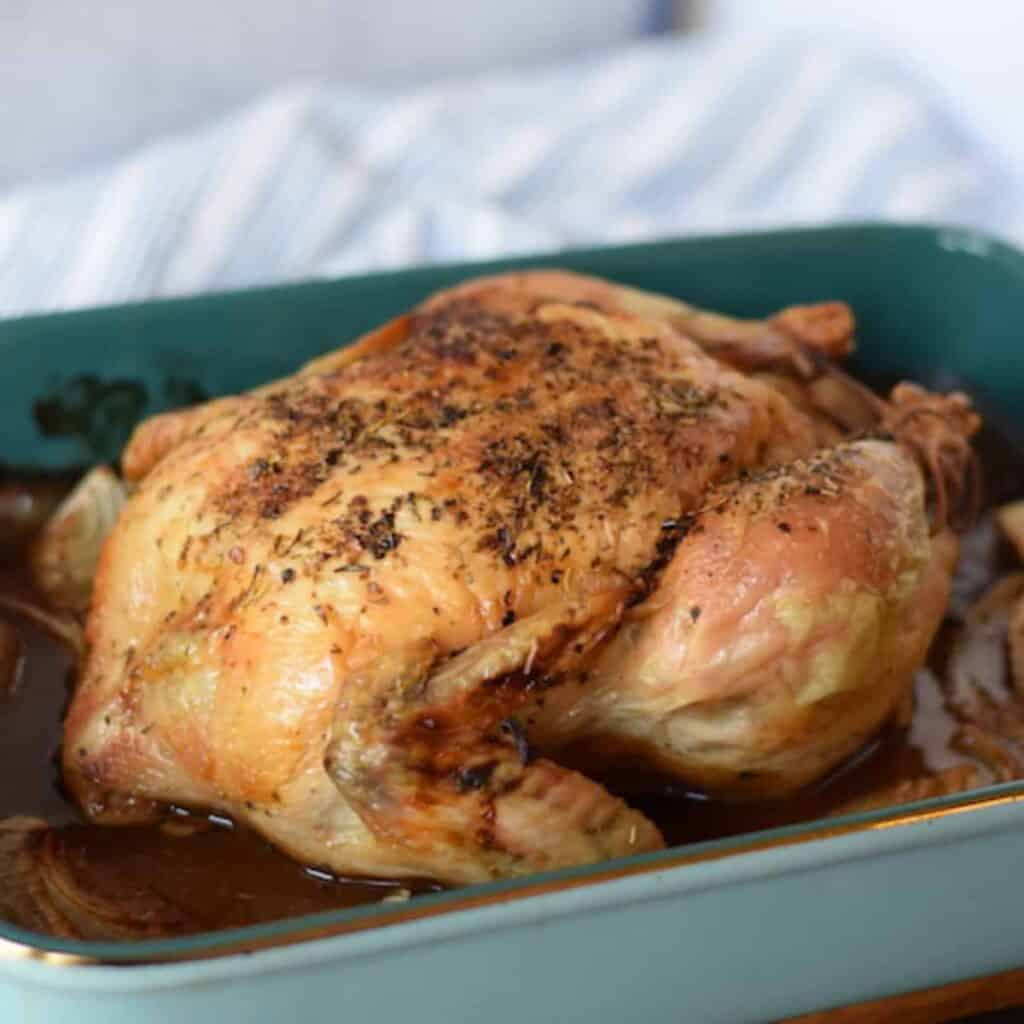 Italian roast chicken in a blue baking dish