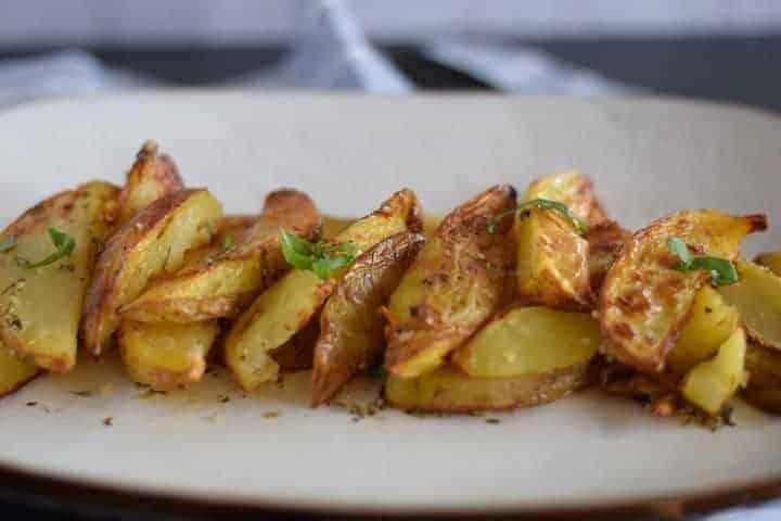 italian potatoes on a white platter