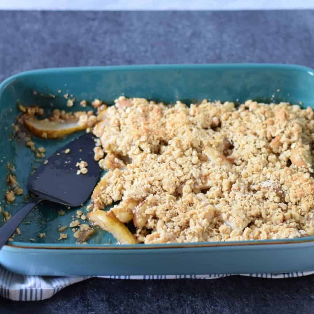 pear crisp in a blue baking dish