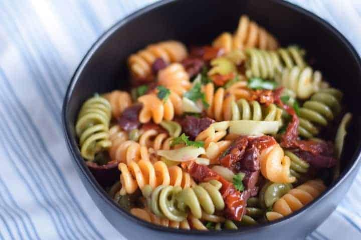 mediterranean pasta salad in a black bowl