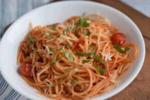 spaghetti with basil garnish