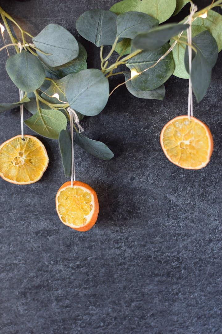 christmas decor dried oranges hanging on a string