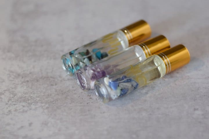 Essential oil roller bottle recipes in clear bottles with gold tops