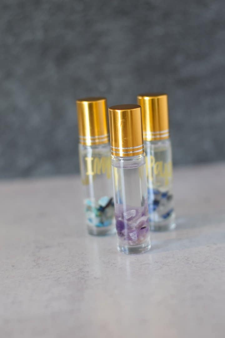 clear essential oil roller bottles with a gold top