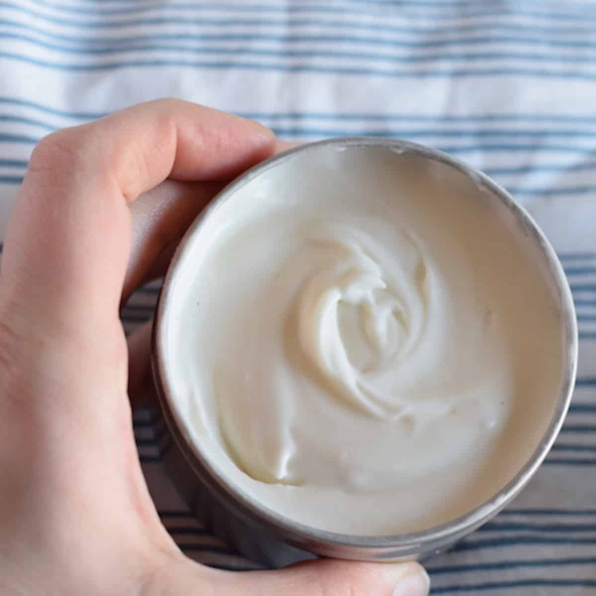 homemade body butter in a metal tin