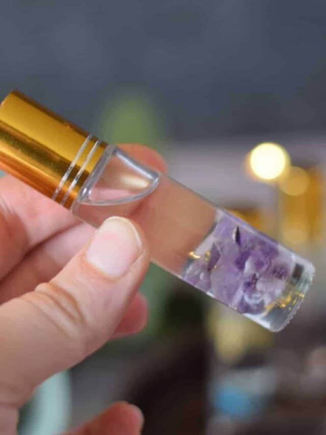 essential oil roller bottle with amethyst rocks