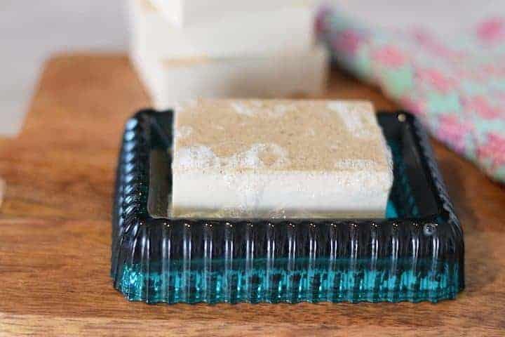 homemade oatmeal soap bar on a blue soap dish