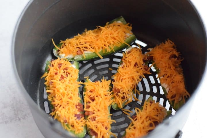 jalapeno poppers in air crisp basket of Ninja Foodi