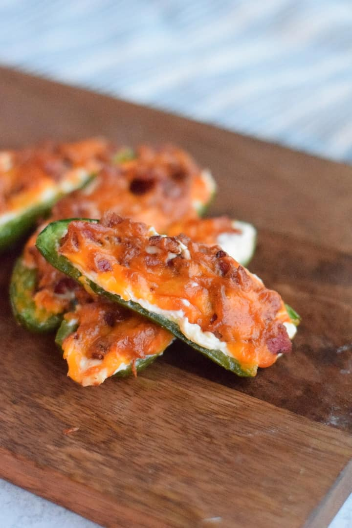 finished Ninja Foodi jalapeno poppers on a wooden cutting board