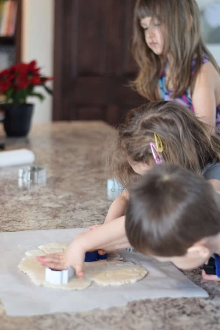 children making ornaments with cookie shapes