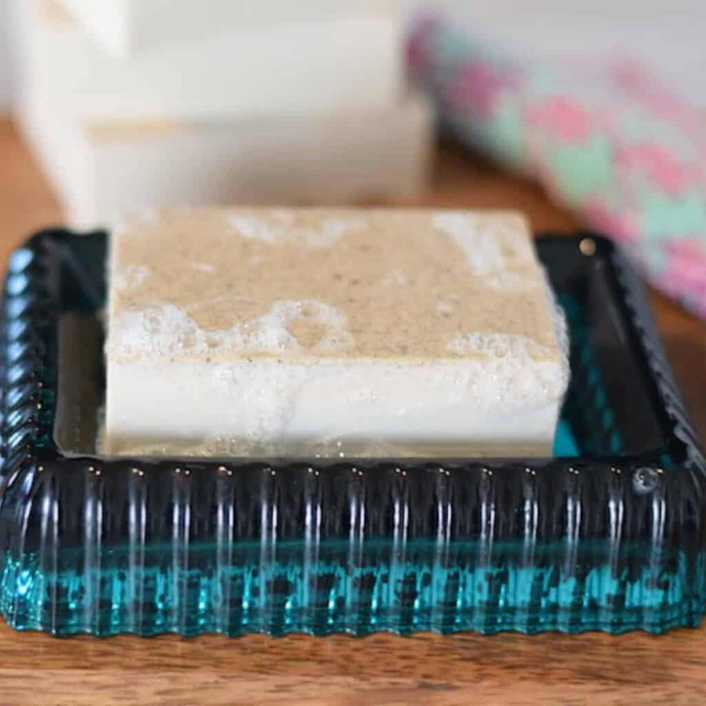 homemade oatmeal soap bar on a blue soap dish