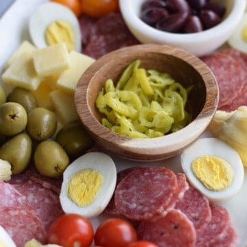 antipasto platter spread over a white tray