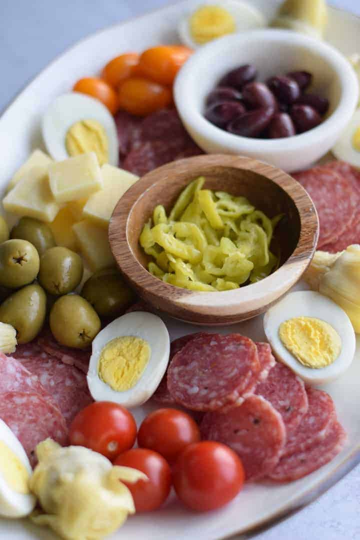 full view of the Italian antipasto platter on a white tray