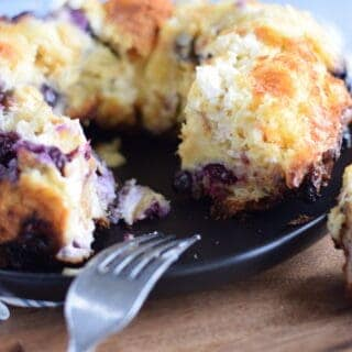 blueberry bread pudding on a wooden cutting board