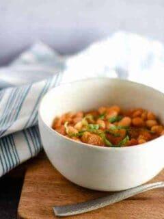 simple greek bean soup in a white bowl