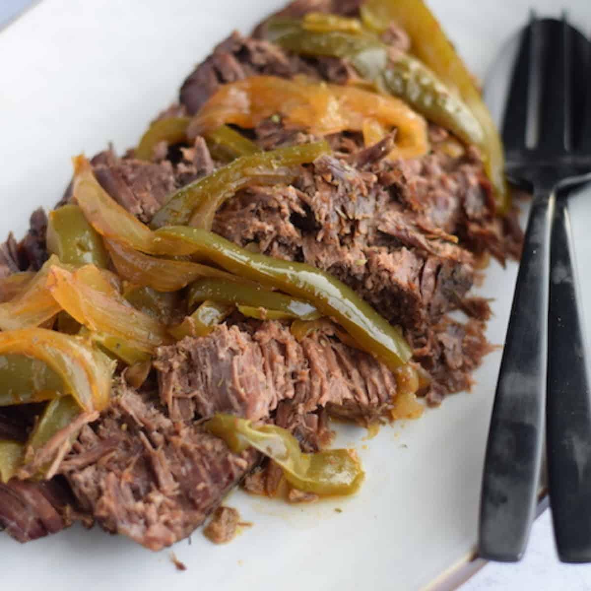 Italian roast beef on a white platter
